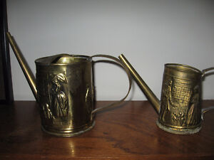 two brass watering cans