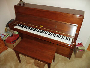 Superb Yamaha console acoustic piano in fantastic condition