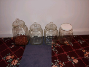 4 clear glass jars with lids