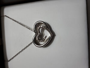 Sterling silver floating heart necklace.