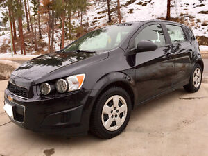 Like NEW 2013 Chev Sonic Hatchback with warranty and extra tires