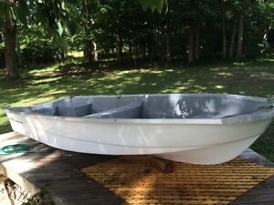 "For sale 9.9 Johnson motor and 12"" fibreglass boat"