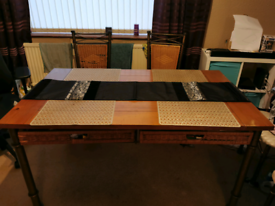 6 seater dining table. Solid wood with brass frame & wicker draws.