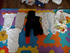 Lot of new born clothing and items.