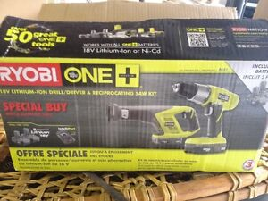 New in box RYROBI  18V drill and Reciprocating Saw kit and cha