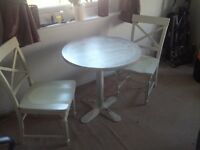 2 chairs and round table