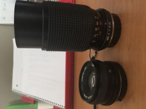 200 mm zoom and 50 mm Yashica lenses for sale.