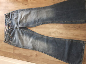 Bell bottom style siver jeans ...like new