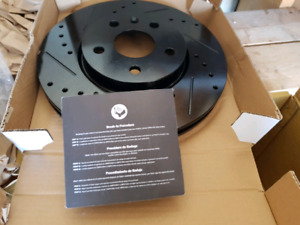 Brake rotors and pads, NIB. Fit some Buick, Chevrolet. Black