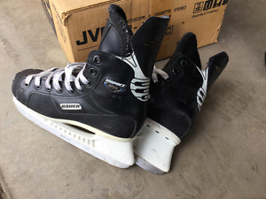 Several pairs of kid size hockey skate boots