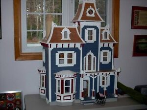 Large stately Victorian doll house. lights & turntable. Bargain.