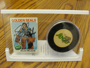 Gilles Meloche signed card and Golden Seals Puck