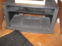 TV Stand with room to store dvd player and movies