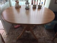 Oval light wood dinning table