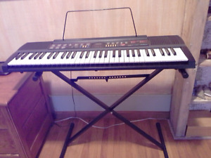 Casio CTK 480 electronic keyboard with stand