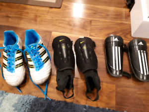 One and a half size Adidas Predator soccer shoes and shin guards