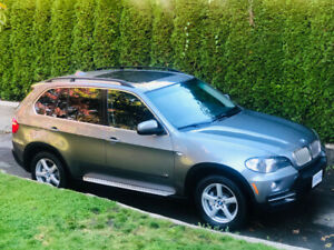 BMW X5 4.8i , seven passenger, with tow hook