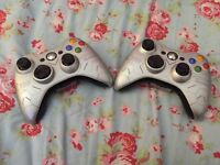 Two Xbox 360 halo edition controllers