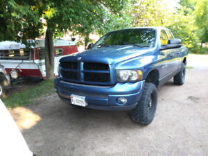 I got a 202 dodge 4x4 truck for sale or trade