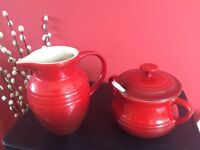 Le Creuset red jug and sugar pot with spoon