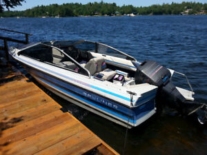 17' Bayliner Capri Bowrider boat with 85 HP outboard.