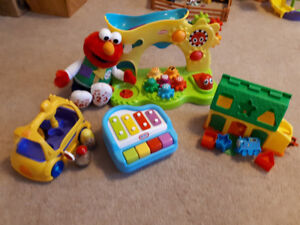 Elmo, Weebles Bus, Thomas, Piano, assorted toys