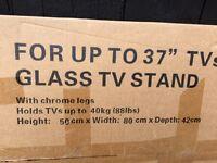 Glass tv stand still in box