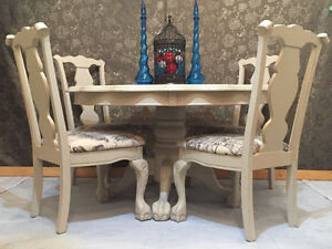 Unique scalloped edge table and four matching chairs