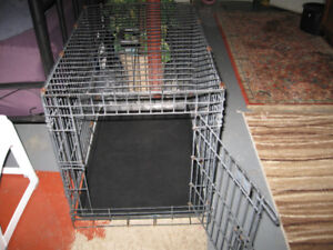 Black Metal medium size dog cage with rubber tray bottom. Has tw
