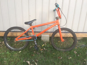 Bright orange Hutch bmx bike