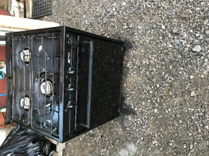 Camping trailer stove