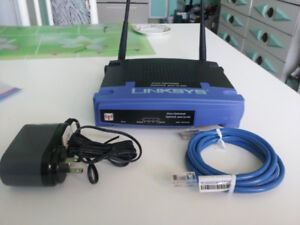 New Linksys wireless-G model WRT54G Router with Adapter and all