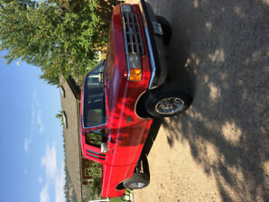 1988 Red Ford super cab, 4x4, diesel truck, long-box