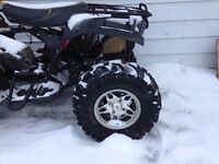 Quad wheels and bear claw tires