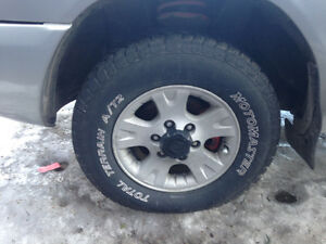 set of 4 rims and tires , dont miss out !!!