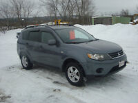 2007 MITISIBUSHI OUTLANDER AWD $5950 TAX'S IN CHANGED INTO NAME