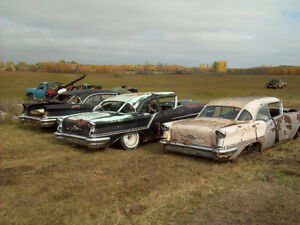 Three 57 Oldsmobiles