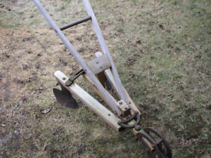 old horse drawn garden plow/cultivator