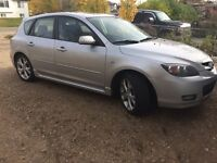 2007 Mazda 3 with set of winter tires and roof rack