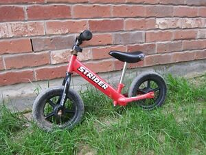 """12"""" strider balance bike with extended seat post"""