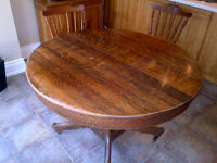 Solid Oak Round Pedestal Dining Room table with three extensions