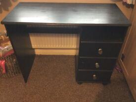 Solid black desk