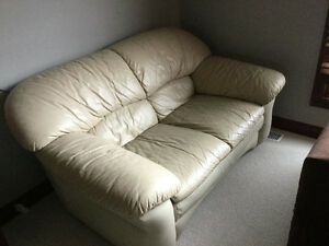 Beige leather sofa and love seat