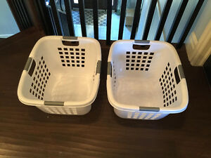 2 white laundry hampers