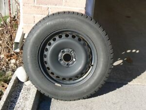 Snow Tires 215/65 R16. A set of four tires on steel rims.