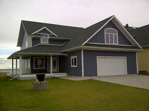 Year Round Lake Front Living in Private Community Pigeon Lake