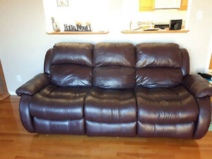 Leather couch and oak hutch