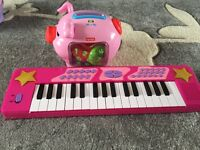 Fisher price piggy bank and pink keyboard