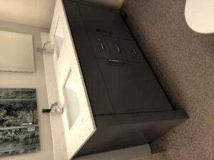 Custom grey contemporary vanity with quartz top