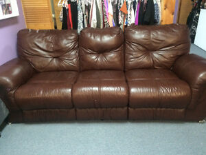 2 brown leather reclining couches